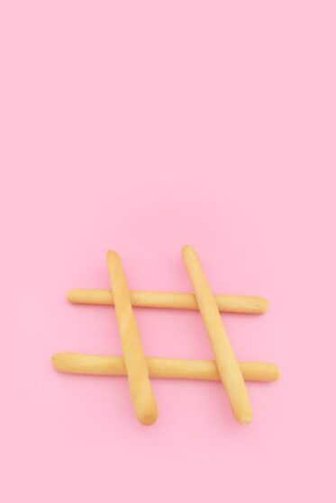 A mad of sticks, placed on a pink background
